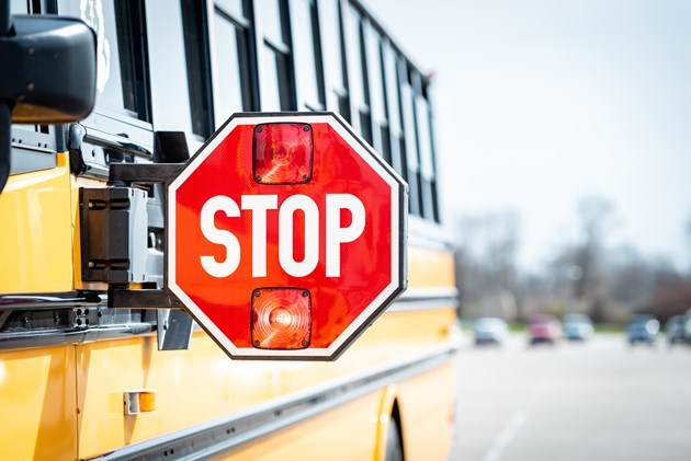 school-bus-stop-adobestock_201099335.jpg